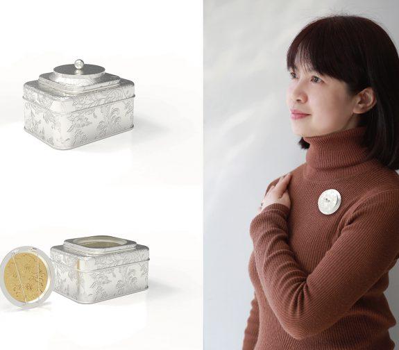 A brooch designed for Min hidden in a tin box
